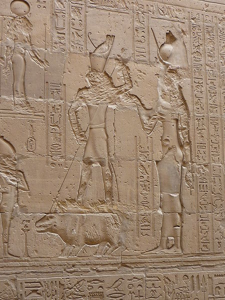 Horus spears Set, who appears in the form of a hippopotamus, as Isis looks on