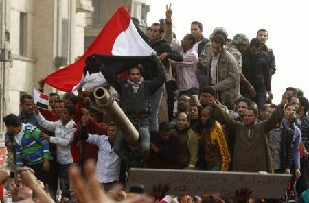 Protestors on a tank