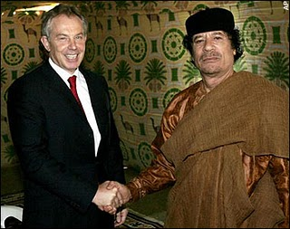 A Terrorist supporting War Criminal and oppressor of his people ,shakes hands with Col.Gaddafi